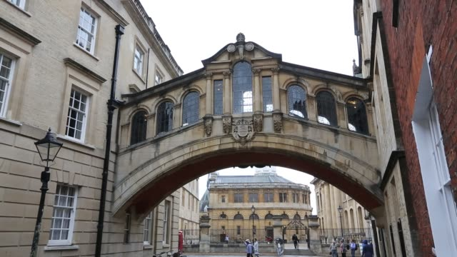 the famous bridge of sighs, connecting the two halves of hertford college in oxford, uk. - doorway stock videos & royalty-free footage