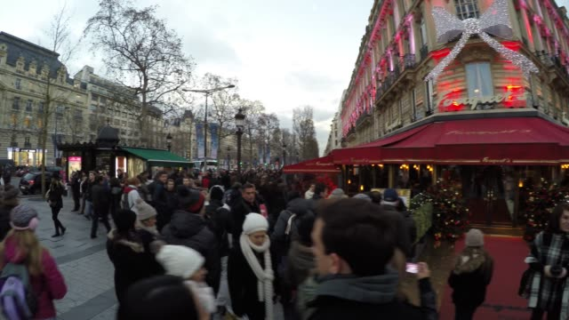 the famous champs elysees in paris, france - avenue des champs elysees stock videos & royalty-free footage