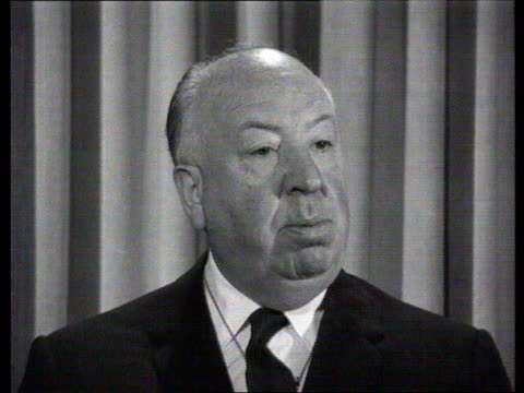 the famous faces collection film director alfred hitchcock interviewed alfred hitchcock interviewed talks about the beginings of our interest in... - collection stock videos & royalty-free footage