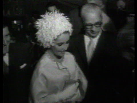 the famous faces collection tx london dominion cinema b/w footage of hollywood actress elizabeth taylor surrounded by crowd of people walking along... - cleopatra stock videos & royalty-free footage