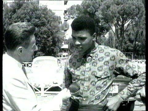 the famous faces collection tx cassius clay explains how he got his name rome tom barry interviewing boxer cassius clay asked how he got his roman... - アメリカ黒人の歴史点の映像素材/bロール
