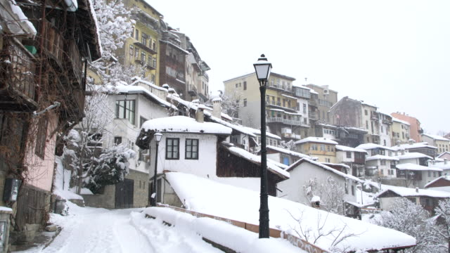 the famous gurko street in veliko tarnovo, covered by snow - panning stock videos & royalty-free footage