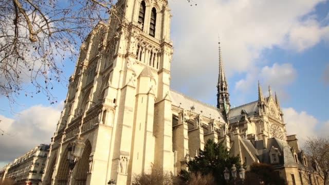 the famous notre dame cathedral in paris, france - notre dame de paris stock videos & royalty-free footage
