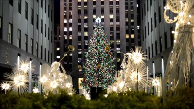 the famous rockefeller center christmas tree in new york has been lit wednesday night during a festive ceremony. clean : new york the famous on... - rockefeller center christmas tree stock videos & royalty-free footage