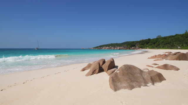 the famous tropical beach petite anse at la digue island. petite anse, la digue, seychelles, indian ocean, africa. - naturwunder stock-videos und b-roll-filmmaterial