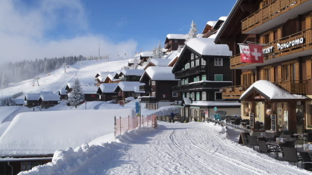 the famous village bettmeralp in winter with restaurants and ski lift. bettmeralp, canton valais, switzerland. - ski lift stock videos & royalty-free footage