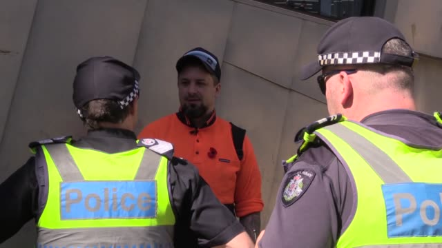 The farright and antiIslam activist Neil Erikson provokes Muslims who perform Friday prayer at Federation Square within Muslim arts festival...