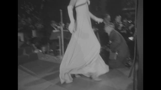 the fashion show portion of the imperial ball a night in monte carlo / wide back shot of people standing along either side of a dinner table with lit... - 舞踏会点の映像素材/bロール