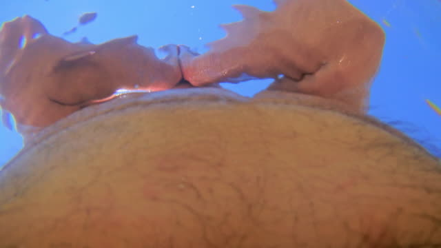 the fat mature man swimming in the lake - stomach stock videos and b-roll footage