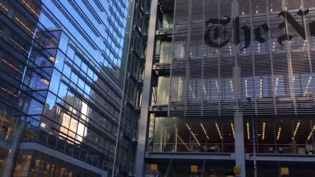 the fbi is investigating russian hackers attempts to hack the ny times shots of the main entrance of the ny times as well as shots of the nytimes sign - ニューヨークタイムズ点の映像素材/bロール