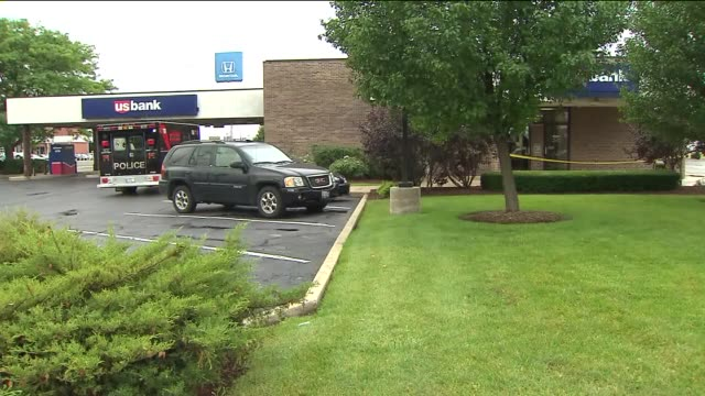 the fbi is looking for the 3 men who robbed a us bank at gun point lansing police truck at bank after robbery on august 22 2013 in lansing illinois - lansing stock-videos und b-roll-filmmaterial