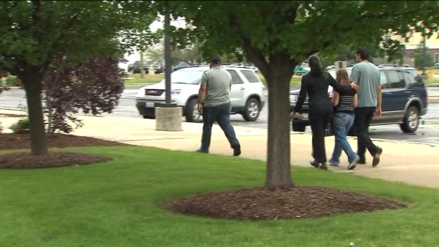 the fbi is looking for the 3 men who robbed a us bank at gun point people leaving the bank after robbery on august 22 2013 in lansing illinois - lansing stock-videos und b-roll-filmmaterial