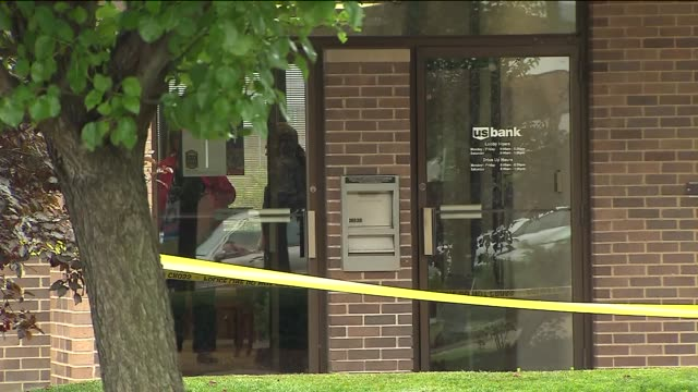 the fbi is looking for the 3 men who robbed a us bank at gun point crime tape at bank after robbery on august 22 2013 in lansing illinois - lansing stock-videos und b-roll-filmmaterial