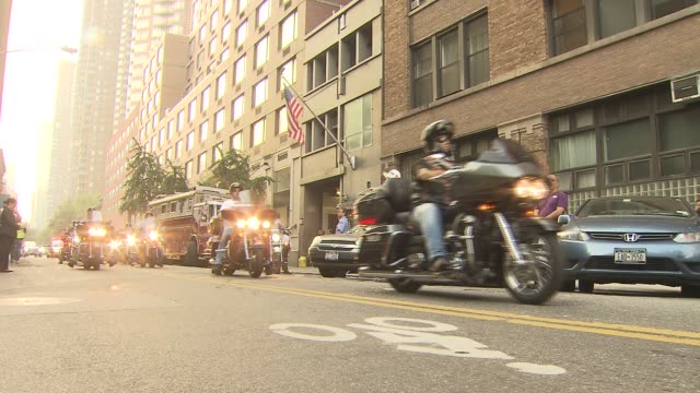 vídeos de stock, filmes e b-roll de the fdny motorcycle club holds a special tribute ride for fallen victims of the september 11th attacks accompanied by billy joel and paul teutul jr... - billy joel