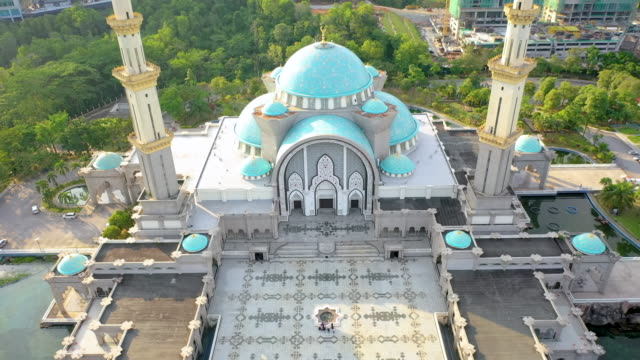 the federal territory mosque, or masjid wilayah persekutuan, kuala lumpur, malaysia on sunset. - mosque stock videos & royalty-free footage