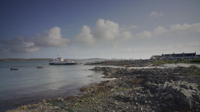 the ferry arriving in the village baile mòr, iona, scotland - pilgrimage stock videos & royalty-free footage