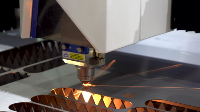 the fiber laser cutting machine cutting the sheet metal plate with the sparking light. hi-technology manufacturing concept. - laser stock videos & royalty-free footage