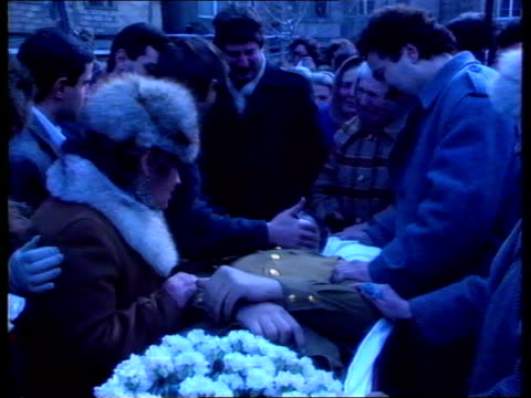 vídeos de stock, filmes e b-roll de armenia tgv body of orson ameria carried in open coffin along towards and laid on table in f/g ms grieving relatives kissing body in coffin seq mass... - azerbaidjão