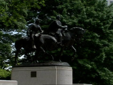The figures of General Robert E Lee his beloved horse Traveler and an aid are featured in this war memorial at Lee Park in Dallas