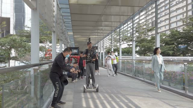 the filming team working,guangzhou,china. - digital display stock videos & royalty-free footage