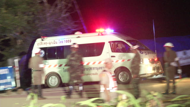 the final ambulances depart the tham luang cave area with 12th and 13th persons after divers evacuated some of the boys among a group of 13 trapped... - タイ文化点の映像素材/bロール