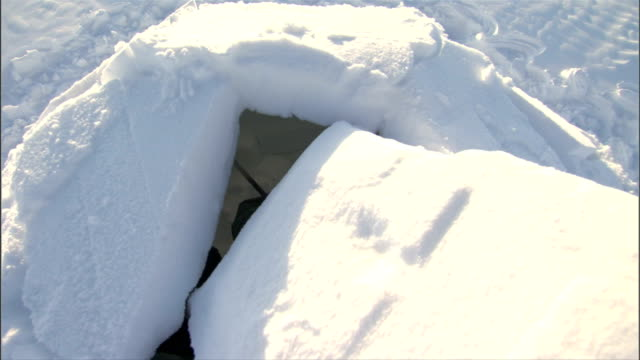 the final piece of igloo is put into place. available in hd. - igloo stock videos & royalty-free footage