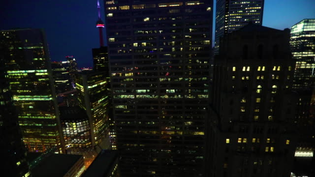 the financial district and toronto skyline at night looking toward the lake - cn tower stock videos & royalty-free footage