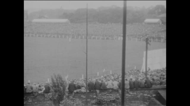 the first day of the 3rd ashes test match between england and australia at headingley in leeds, 10th july 1926; england being led out by their... - ashes test stock videos & royalty-free footage
