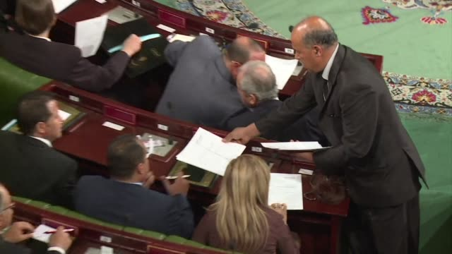 the first democratically elected parliament in tunsia met on thursday to elect its president - politik und regierung stock-videos und b-roll-filmmaterial