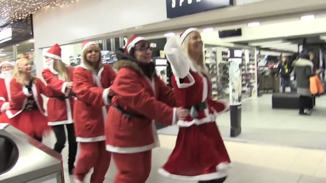 The first ever charity Santa Conga takes place at St Johns shopping centre in Liverpool to raise money for Claire House Childrens' Hospice