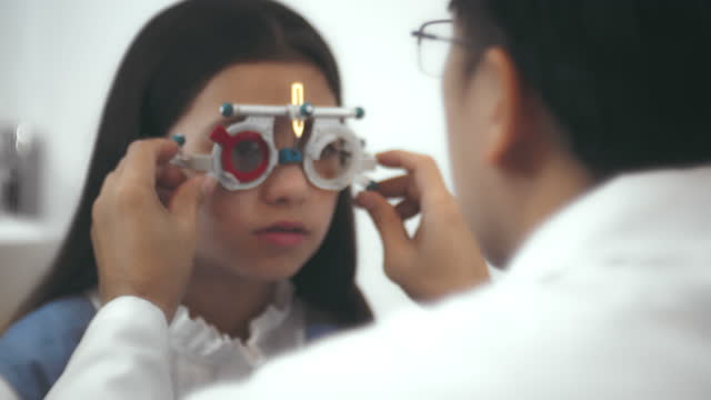 the first glasses in my life - lens optical instrument stock videos & royalty-free footage