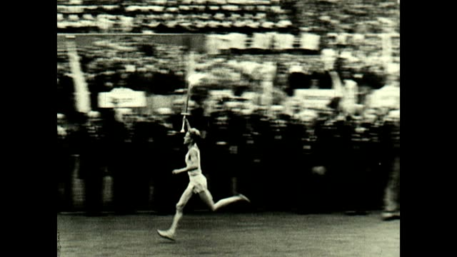 the first olympic torch relay takes place at the 1936 olympics with siegfried eifrig running into the olympiastadion followed by fritz schilgen who... - international match stock videos & royalty-free footage