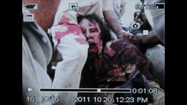 the first photo of moamer kadhafi shows the former libya strongman covered in blood photograph emerges of apparently wounded kadhafi on october 20... - muammar gaddafi stock videos & royalty-free footage