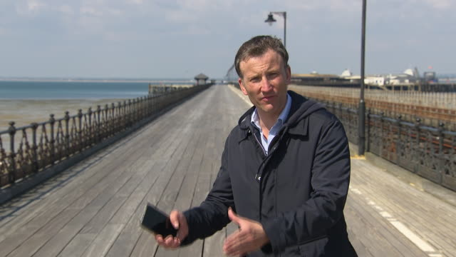 vídeos y material grabado en eventos de stock de the first rollout of an nhs covid19 smartphone app, starts on the isle of wight today. the system traces when people come into contact with each... - reportaje imágenes