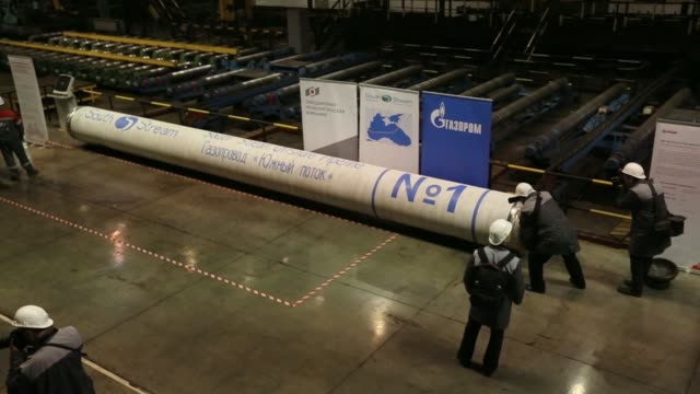 the first seamless steel pipe section manufactured for use in the second stage of the south stream gas pipeline sits at the vyksa steel works... - minerale di ferro video stock e b–roll