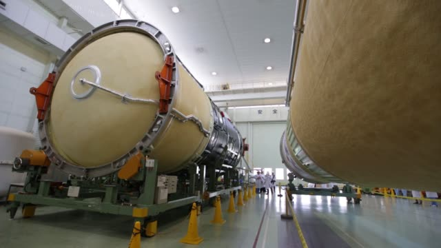 stockvideo's en b-roll-footage met the first stage of the h-2a flight 31 launch vehicle, manufactured by mitsubishi heavy industries ltd., stands on display at the company's nagoya... - plant stage