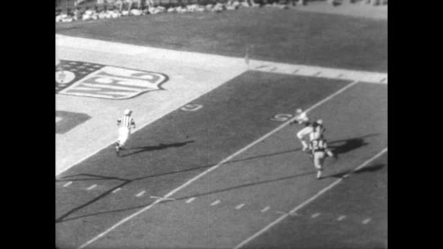 The first Super Bowl game played in Los Angeles by Kansas City Chiefs and Green Bay Packers / band creates shape of an eagle on the football pitch /...