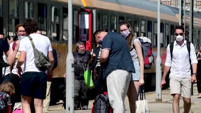 stockvideo's en b-roll-footage met the first train from the czech capital prague arrives at rijeka railway station on the northern adriatic sea with 520 czech and slovak tourists on... - oost europese cultuur