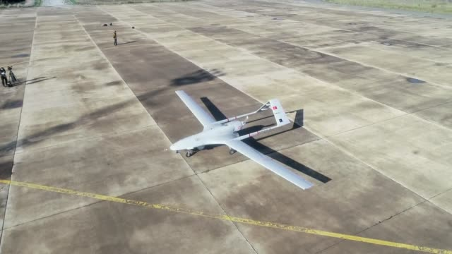the first turkish military drone on monday landed at gecitkale airport in the eastern coastal city of magusa in turkish republic of northern cyprus... - 無人航空機点の映像素材/bロール