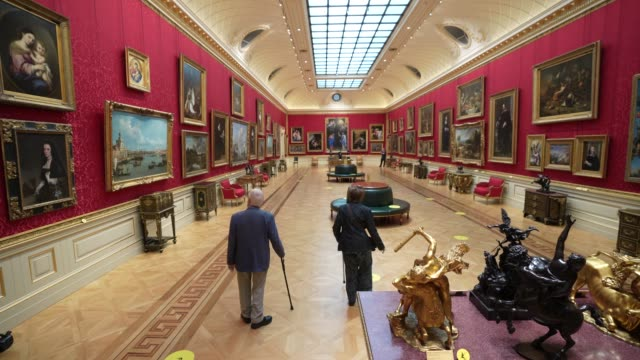 the first visitors through the door explore the galleries of the wallace art collection on july 15, 2020 in london, england. as the country further... - art gallery stock videos & royalty-free footage