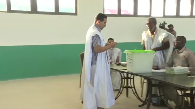 the first voters arrive at a polling station in nouakchott mauritania - nouakchott stock videos & royalty-free footage