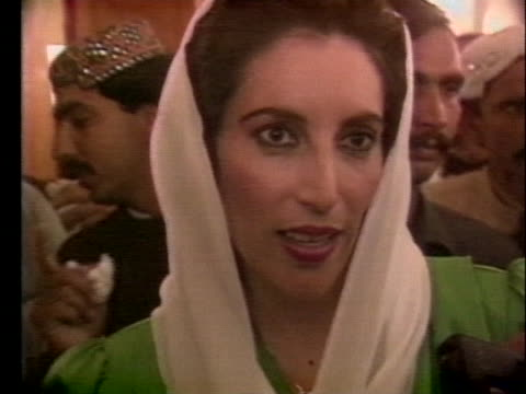 the first woman muslim prime minister benazir bhutto says she hopes to make the best use of her time to give pakistan a sense of unity and dignity. - (war or terrorism or election or government or illness or news event or speech or politics or politician or conflict or military or extreme weather or business or economy) and not usa stock videos & royalty-free footage