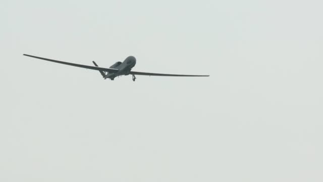 the first-ever rq-4 global hawk to touch down in japan arrived at misawa air base may 24. - unmanned aerial vehicle stock videos & royalty-free footage