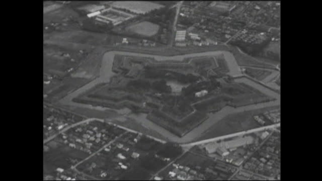 the five star shape of goryokaku park is apparent from above. - fortress stock videos & royalty-free footage