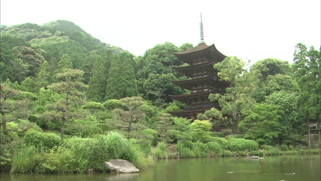 The five storied pagoda of Rurikoji Temple towers above a pond in Yamaguchi.