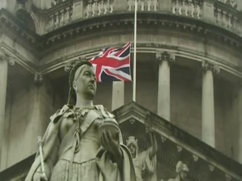the flag at city hall in belfast is lowered to half mast to mark margaret thatcher's funeral. - rathaus stock-videos und b-roll-filmmaterial