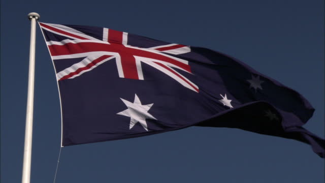 The flag of Australia flutters in a breeze.