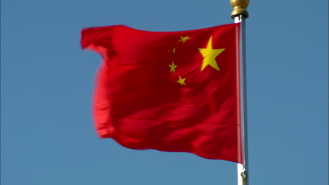 the flag of china waves in the wind. - chinese flag stock videos & royalty-free footage