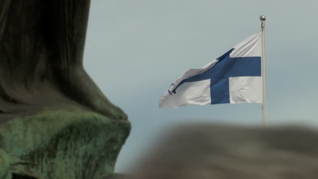 the flag of finland flying in helsinki finland on july 13 2018 - music or celebrities or fashion or film industry or film premiere or youth culture or novelty item or vacations bildbanksvideor och videomaterial från bakom kulisserna
