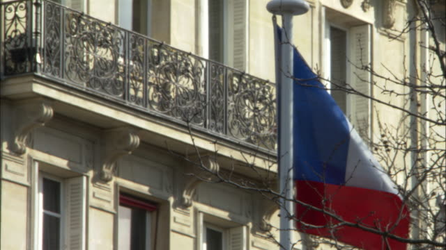 the flag of france waves in a breeze. - french flag stock videos & royalty-free footage
